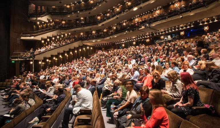Audience at Barbican's performing arts theatre